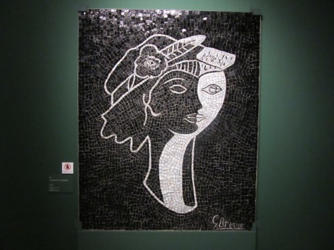 A mosaic of a cubism-like screen composition in which the profile and the front were drawn at the same time